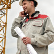 Builder at construction site with phone — Stock Photo #3247769
