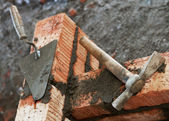 Bricklayer equipment trowel and hack — Stock Photo