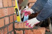 Hands of a mason at bricklaying work — Foto Stock