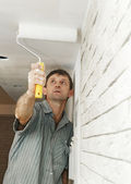 Painter worker painting a ceiling — Stock Photo