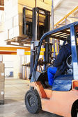 Warehouse forklift loader work — Stock Photo