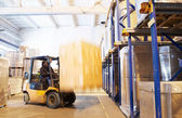 At a warehouse with forklift loader — Stock Photo