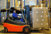 Forklift loader worker at warehouse — Stock Photo