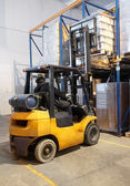 Forklift loader stacking in warehouse — Stock Photo