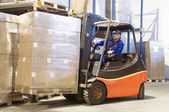 Forklift at work with driver — Stock Photo
