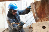 Manual worker in action with hammer — Stock Photo