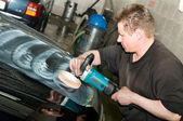 Car polishing worker — Stock Photo