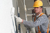 Builder facade painter at work — Stock Photo