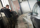 Car cleaning with pressured water — Stock Photo