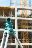 Theodolite at construction site — 图库照片
