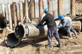 Builders with equipment for piling — Stock Photo