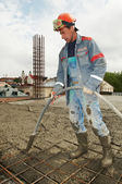 Builder worker pouring concrete into form — Stock Photo