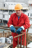 Worker builder at construction site — Stock Photo