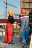 Workers builders at construction site — Stock Photo