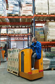 Order picker loader in warehouse — Stock Photo
