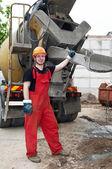 Construction builder and concrete mixer — Stock Photo