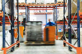 Warehouse truck works — Stock Photo