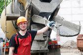 Construction builder and concrete machine — Stock Photo