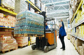 Distribution in warehouse with forklift — Stock Photo