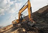 Excavator loader in construction sandpit area — Stock Photo