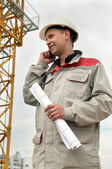 Builder at construction site with phone — Stock Photo