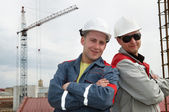 Happy builders at construction site — Stock Photo