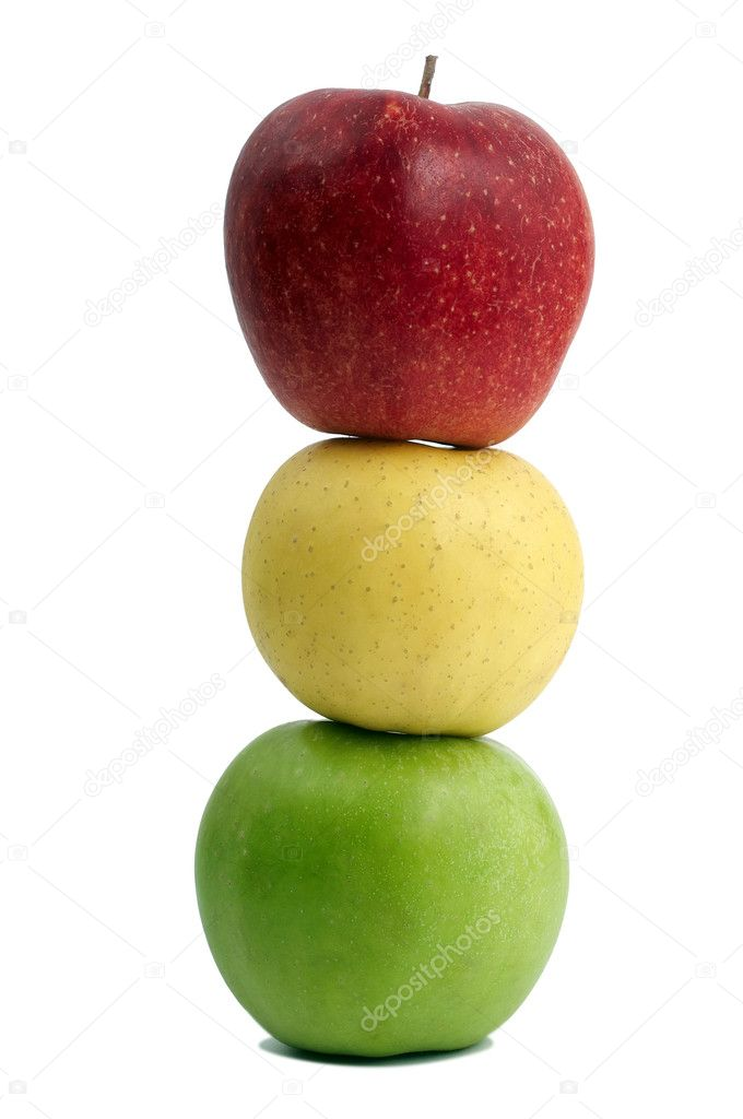 Group of ripe coloured apples standing one on another like traffic lights  Stock Photo #3242644