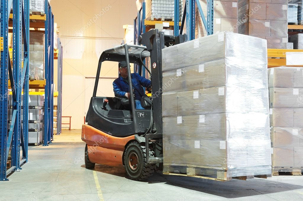 Forklift loader moving at warehouse with a cardboard boxes  Stock Photo #3245111