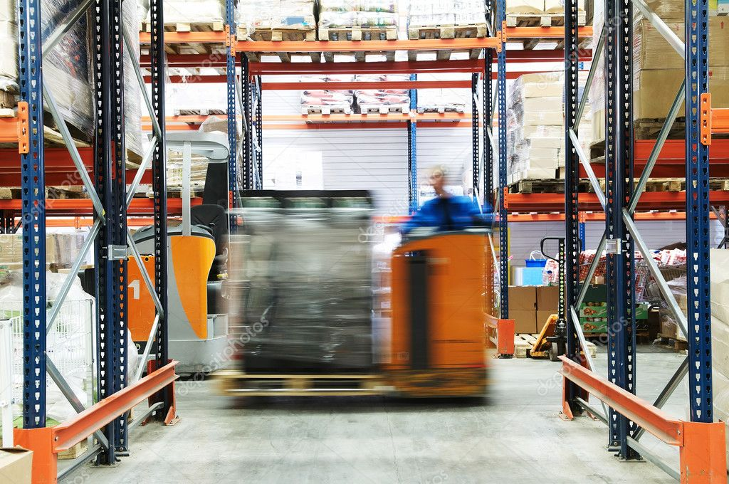 Low level picker loader with driver moving in a warehouse — Stock Photo #3247608
