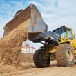Wheel loader at eathmoving works - Stock Photo