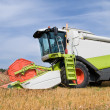 Stock Photo: Working harvesting combine in field