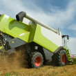 Harvesting combine in field — Stock Photo