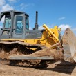 Stock Photo: Bulldozer earthmover in action
