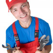 Smiley repairman with spanners — Stock Photo