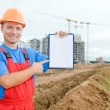 Smiley builder with clipboard — Stok fotoğraf