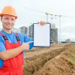 Smiley builder with clipboard — Stockfoto
