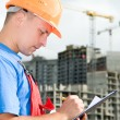 Inspector at construction area - Stock Photo