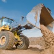 Wheel loader excavation working - Stock Photo