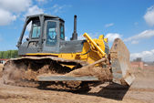 Bulldozer earthmover in action — Stock Photo