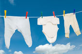 Chilld infant linen on a clothesline — Stock Photo