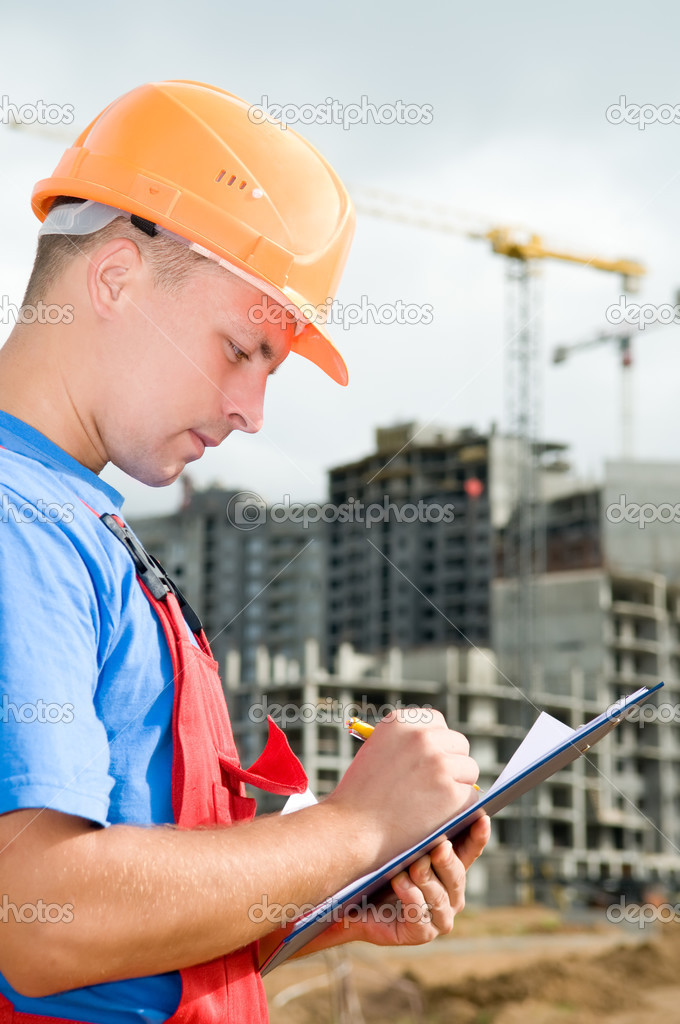 One builder worker writing in clipboard inspecting works at construction site — Stockfoto #3671562