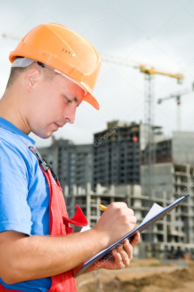 One builder worker writing in clipboard inspecting works at construction site — Foto Stock #3671562