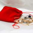 Stock Photo: Red small packet with jewelery