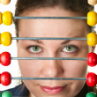 Beautiful woman face and colorabacus — Foto Stock