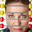 Beautiful woman face and colorabacus — Stock Photo #2877620