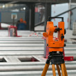 Optical level at factory among equipment — Stockfoto