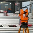 Stockfoto: Optical level at factory among equipment