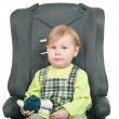 The little girl sits in a car seat — Stock Photo