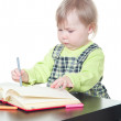 Little girl doing homework — Stock Photo