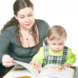 Stock Photo: Little child and mother reading